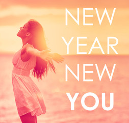 NEW YEAR, NEW YOU inspirational quote on happiness background of girl with open arms in freedom. Self esteem, self-confidence concept for new year resolution. Life change choice for the New Year.