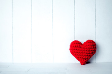 red heart in white room background