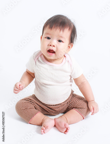 Cute Little Asian Baby Boy Sitting Isolated On White Background
