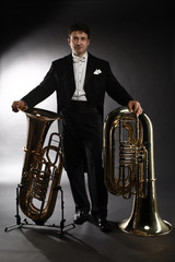 Photo sur Aluminium Musique Tuba brass instrument. Classical musician portrait man horn player