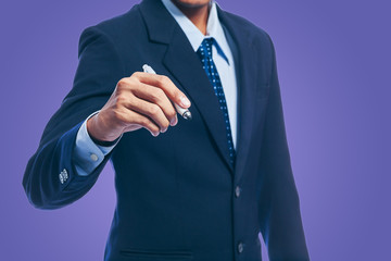 Businessman hand drawing on the screen with whiteboard isolated on blue background