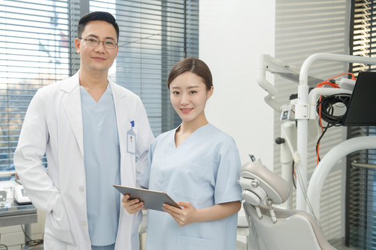 A male dentist and a dental assistant