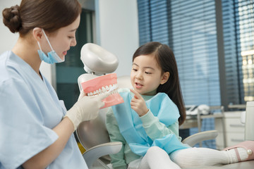 Cute little girl and dentist