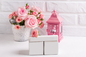Empty calendar with place for your date,  tender pink roses flowers and decorative pink lantern