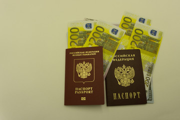 The passport on the background of the banknote. and . Euro banknotes of 200 and fifty. Travel and money.