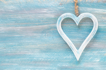 Happy Valentine Day background with variety of decorative hearts on wood with copy space for your text or greeting