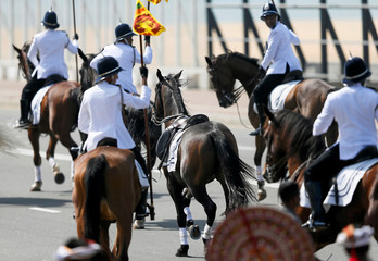 A horse runs away after a mounted police officer falls during a welcome ceremony for Malaysia's Prime Minister Razak in Colombo