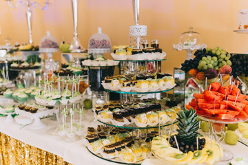 Sweet wedding buffet with different of desserts and fruits.