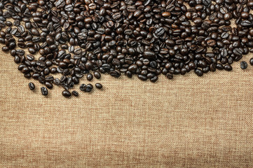 Roasted coffee beans on traditional sack textile, kind of a background