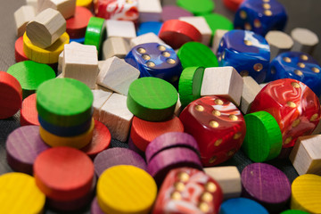 a multicolored pile consisting of dice and wooden chips