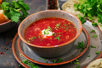 Traditional Ukrainian Russian borscht with beef on the bowl