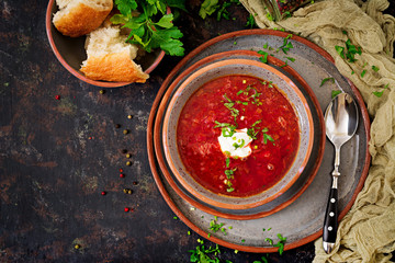 Traditional Ukrainian Russian borscht with beef on the bowl. Top view