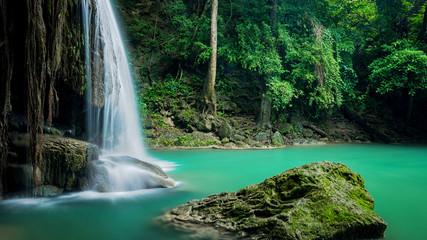 Beautiful green waterfall at deep forest, Erawan waterfall located Kanchanaburi Province, Thailand
