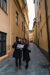 Couple with map on street