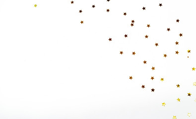 Christmas composition. a pattern of golden christmas stars from above. Flat lay, top view
