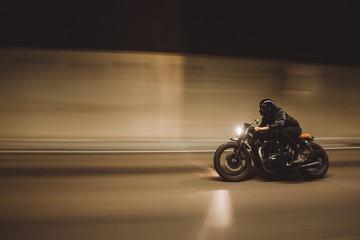 Biker riding in tunnel