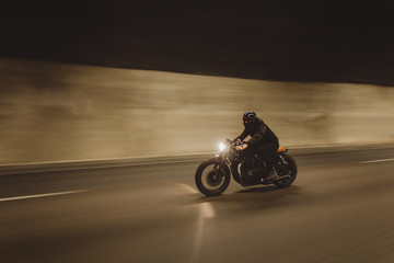 Biker riding in tunnel