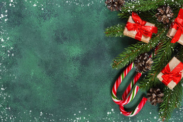 New-year green background with sweets, snowflakes and cones. Happy New Year and Merry Christmas!