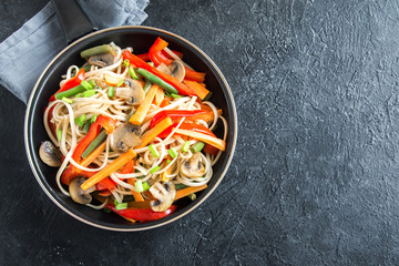 Stir fry with udon noodles and vegetables