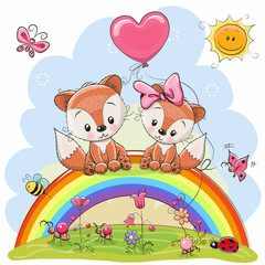 Two Foxes are sitting on the rainbow