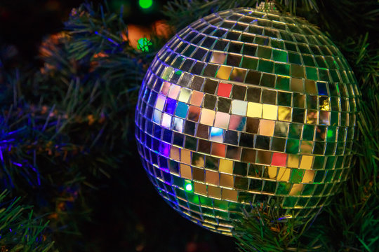 Magic Christmas ball of mirror pieces on an artificial Christmas tree close