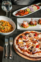 Pizza, Chicken Tandoori, Chicken briyani, Indian and Italian famous cuisine