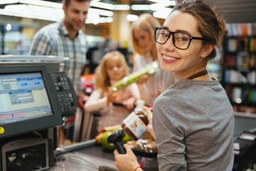 Happy cashier woman on workspace