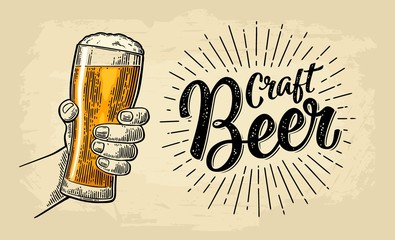 Male hand holding beer glass. Craft Beer calligraphic lettering