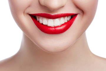 Healthy white smile close up. Beauty woman with perfect smile, lips and white teeth. Beautiful Model Girl with red lips isolated on white background. Teeth whitening and cleaning, dental care.