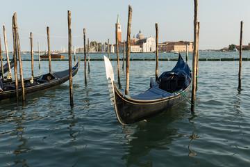 gondola moored on a canal, Venice, Italy