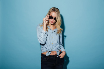 Picture of a Cool blonde woman in shirt and sunglasses