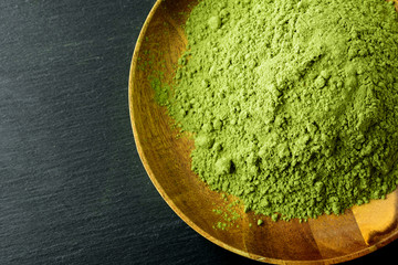 Japanese green tea matcha in a wooden bowl