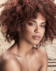 Girl with afro hairstyle posing.