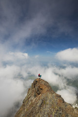 High angle view of friends standing on Cheam Peak amidst clouds