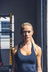 Portrait of confident woman standing in gym