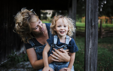 Portrait of daughter with mother at farm
