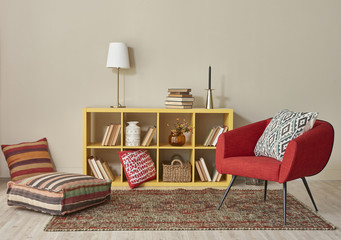wooden bookshelf in the living room with chair and pillow style books