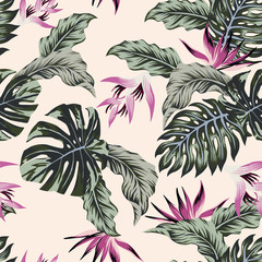 Exotic flowers tropical leaves green seamless light pink background