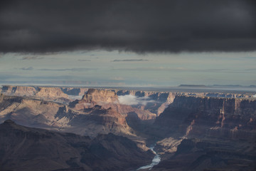 High angle scenic view of rock formations against stormy clouds at Grand Canyon National Park