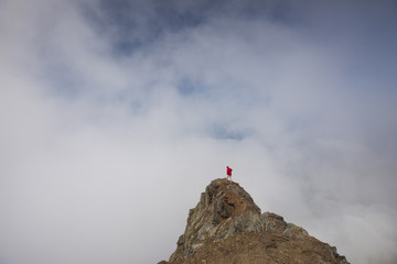 High angle view of hiker standing on Cheam Peak against cloudy sky