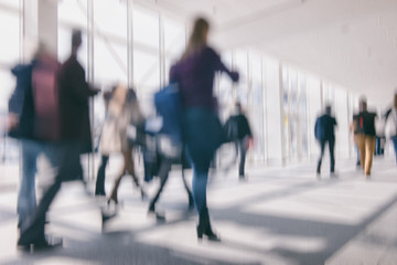 defocused background of business people walking in a floor, business travel concept