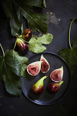 Overhead view of figs in plate on table