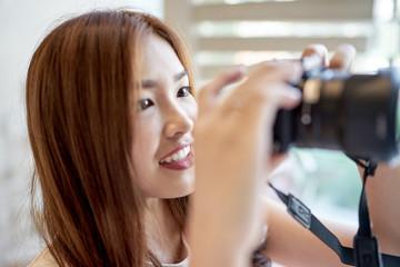 Asian beautiful girl taking a photo.