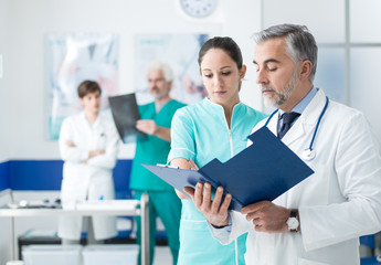 Doctor and nurse examining medical records