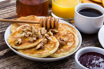 Mother's day brunch with  delicious pancakes with honey and nuts