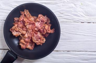 Sliced fried bacon