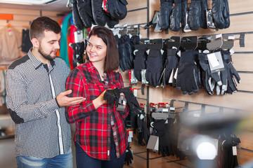 Couple deciding on protective gloves