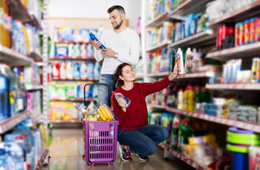 People buying detergents for house