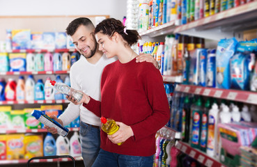 Couple choose some detergents