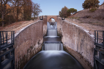 Waterfall in Touristic attraction Canal de Castilla, famous landmark in Palencia, Spain.